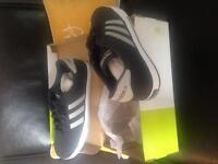 Men's size 11 Brand NEW ADIDAS shoes