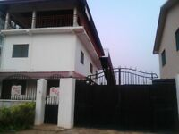 3-floor Commercial property plus 3-Bed Bungalow in Accra. On a 100' x140' plot. Lots of grounds.