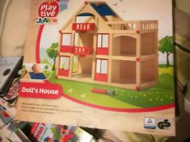 Brand new wooden dolls house