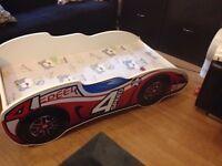 Kids racing car bed. NEW