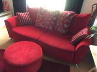 Grey and red sofa and swivel chair