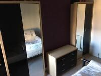 2 Wardrobes and a Chest of Drawers, mirror/black doors
