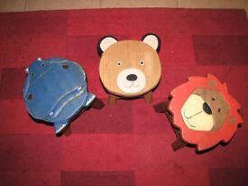 3 Much loved wooden children's stools - carved animal heads in shape of lion, bear and hippo.