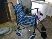 Wheelchair lightweight with twin brakes swivel wheels fully adjustable and folds up ex condition