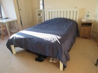 Near new white double bed base with mattress. Matching bedroom furniture. Excellent condition.