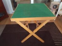 Folding green card table.