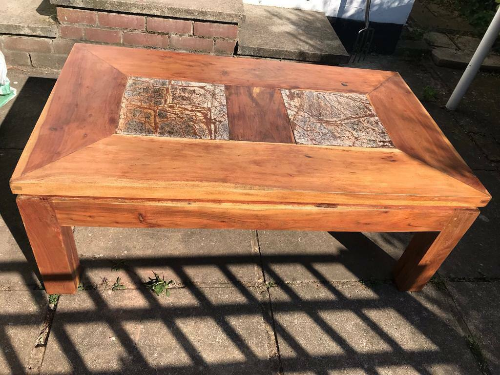 Solid cherry wood coffee table with marble tiles