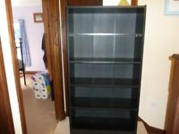 2 Black Ask Bookcases in good condition. Each has 5 shelves.