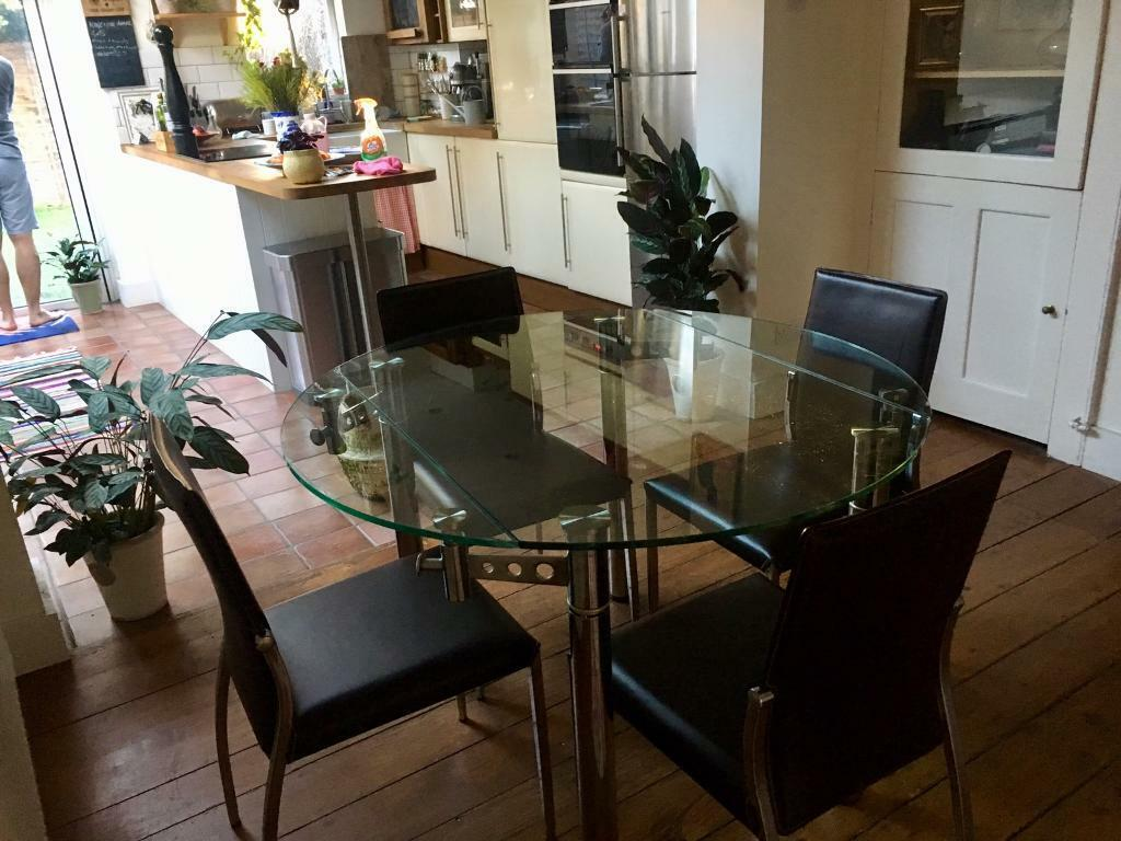 Dwell Extendable Clear Gl Dining Room Table And 4 Leather Chrome Chairs