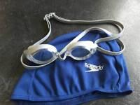 AS NEW: Speedo swimming goggles and Speedo swimming cap.