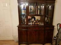 Wall unit. Does have lights inside display area. And got keys as cupboards lockable