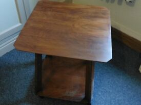 Square occasional table on castors
