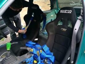 Sparco rev bucket seats with harnesses and side mounts