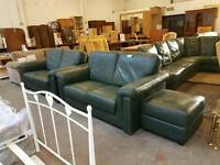 Green twin two seater sofas suite with small pouffe