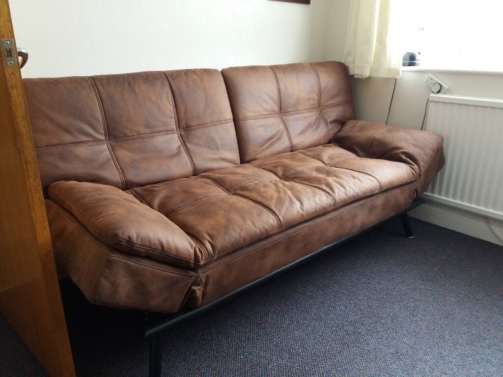 faux leather sofa bed, little used. reduced price for quick sale
