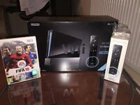 Wii console including Fifa 2010, extra controller and Wii sports + sports resorts package