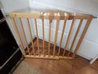 Baby Dan wooden adjustable stair gate.