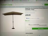 Brand new and still boxed parasol and base