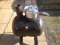 Gas bottle wood burner.