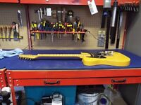 Miller Guitar Works - restring, setup and repairs for all guitars.