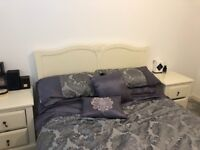 Good condition wooden matching bedframe, bedside tables and tall chest of drawers with vanity mirror