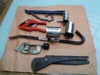 Plumbing tools and pipe repair clamps