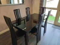 Harvey's black glass extendable dining table with 6 x chairs