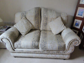 2 seat cream and blue fabric sofa in excellent condition