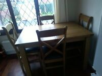 Oak dining table & four chairs.