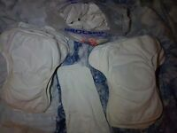 Reusable/cloth nappies 25 nappies and 16 wraps.