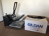 T shirt heat press with box of Black Gildan t shirts in different sizes