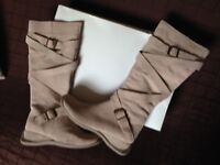 Ladies suede boots. Brand new never worn. Too narrow round calf. Wedge heel size 5