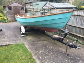 Drascombe Lugger, circa 1976. Original gel coat, tan sails, 4hp Yamaha outboard, road trailer.