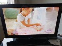 "Samsung 42"" plasma tv and glass tv stand"