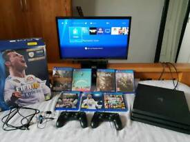 PS4 Pro 4K HDR 1TB, Two Controllers, 7 Games