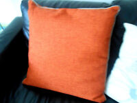 Four cushions for sale two orange and two beige