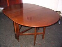 Oval drop leaf table- dining table with hinged flaps, solid wood kitchen table, to seat 6 people.