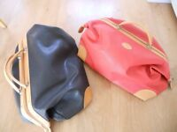 pair of luxury leather holdalls, fully lined and includes shoulder straps