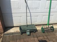 Hand pull lawn scarifier and fertiliser applicator