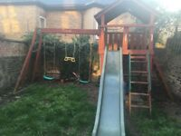 Wooden climbing frame swings slide treehouse