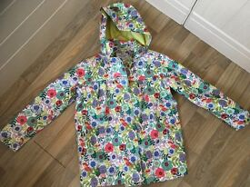 Brand new Peter Storm Raincoat with lime green lining age 9-10 years