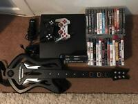 Playstation 3 Slim, loads of games 2 controllers