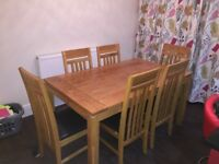 Solid oak furniture for sale. Table and 6 chairs, coffee table and tv cabinet.