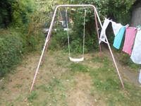 Childrens pink garden swing