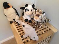 Four plush animal toys (pengiun, cow, leopard, shark)