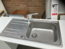 Stainless steel sink with mono tap and waste.