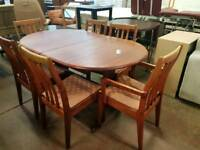 Light mahogany extending table and six chairs