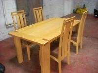 4 DINNING CHAIRS AND WOODEN TABLE HEAVY BUILT . QUALITY . £ 85. CAN DELIVER LOCALLY .
