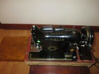 1950's Singer Sewing Machine with light and foot pedal, in case.