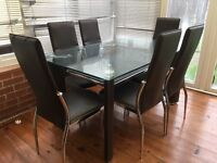 Beautiful glass and leather dining room table and chairs